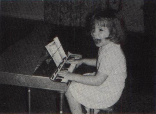 A young Lee playing the piano.